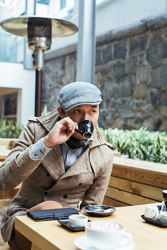 Well-Dressed Asian Hipster Drinking Espresso in Bright Coffee Shop by VISUALSPECTRUM for Stocksy United