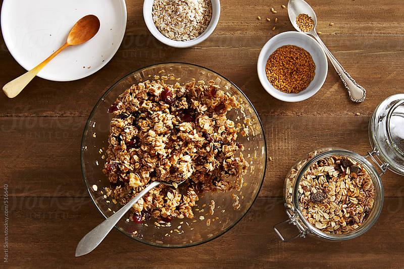 Preparing homemade granola bars by Martí Sans for Stocksy United