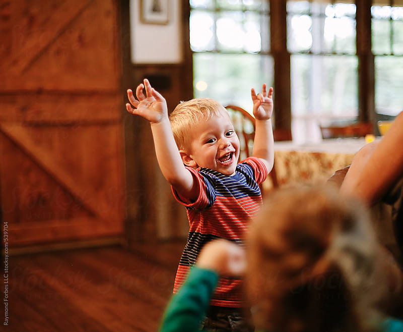 Happy Child at Birthday Party on Vacation by Raymond Forbes LLC for Stocksy United