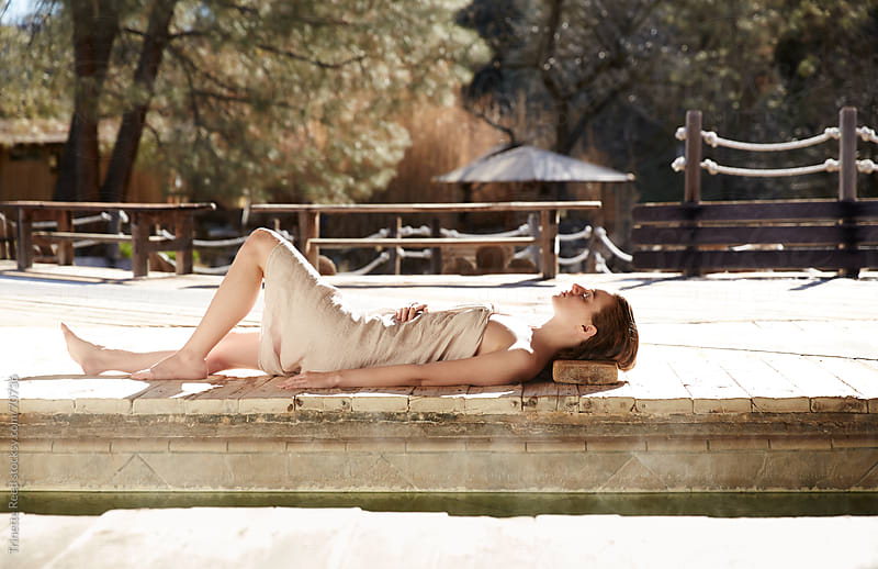 Woman relaxing in Japanese spa and hot springs in California by Trinette Reed for Stocksy United