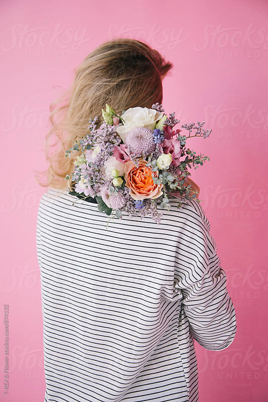 Back view of blonde woman holding bouquet of beautiful flowers by Danil Nevsky for Stocksy United