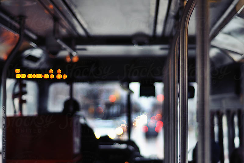 Interior of a streetcar on a rainy day by Amanda Large for Stocksy United