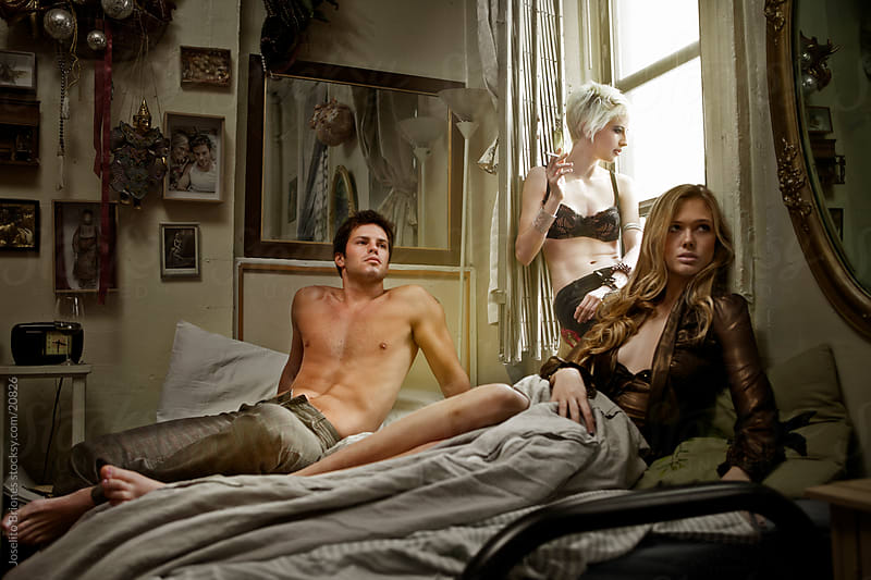 Threesome - Young People in a Bedroom by Joselito Briones for Stocksy United