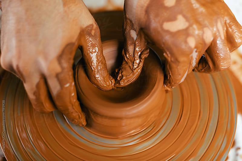 Hands of a ceramist working on a potter's wheel.  by BONNINSTUDIO for Stocksy United