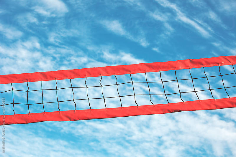 Volleyball net on a blue sky background. by BONNINSTUDIO for Stocksy United