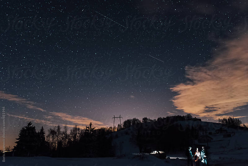 Car under the starry night scape by Boris Jovanovic for Stocksy United