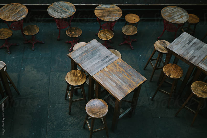 Empty tables and stools by kkgas for Stocksy United
