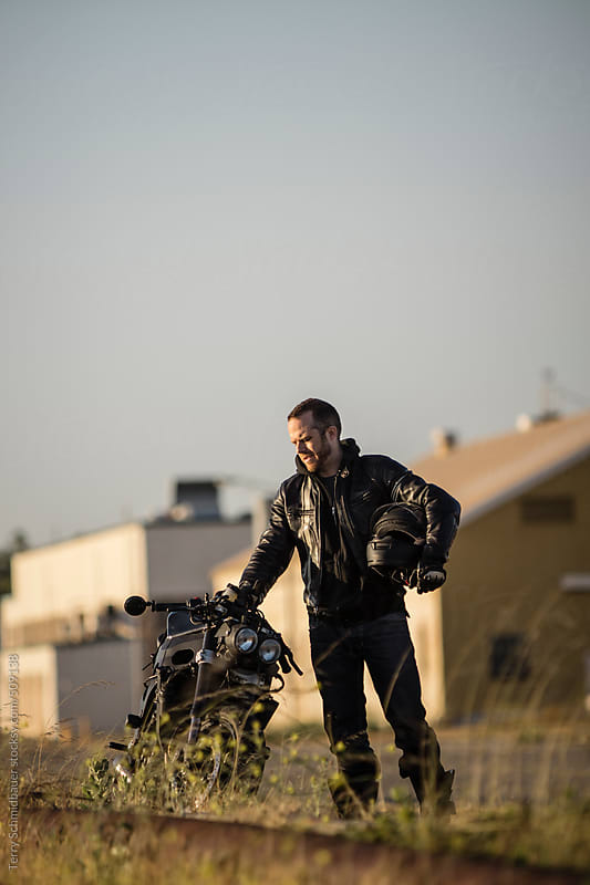 Motorcyclist at a Naval Base by Terry Schmidbauer for Stocksy United