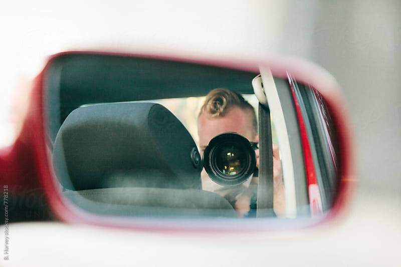 Photographer Shooting Photos in Car by B. Harvey for Stocksy United