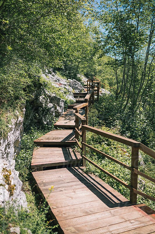 Wooden bridge to the viewpoint to the waterfalls by Maja Topcagic for Stocksy United