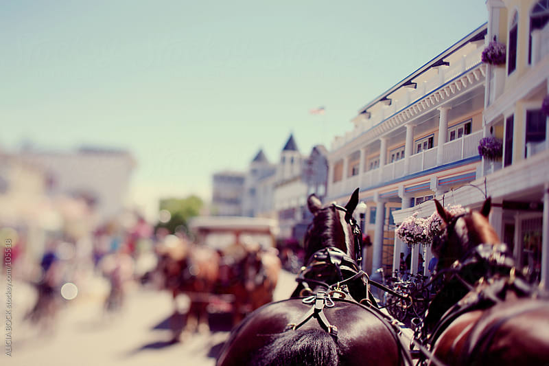 Horse Drawn Carriages On Mackinac Island by ALICIA BOCK for Stocksy United