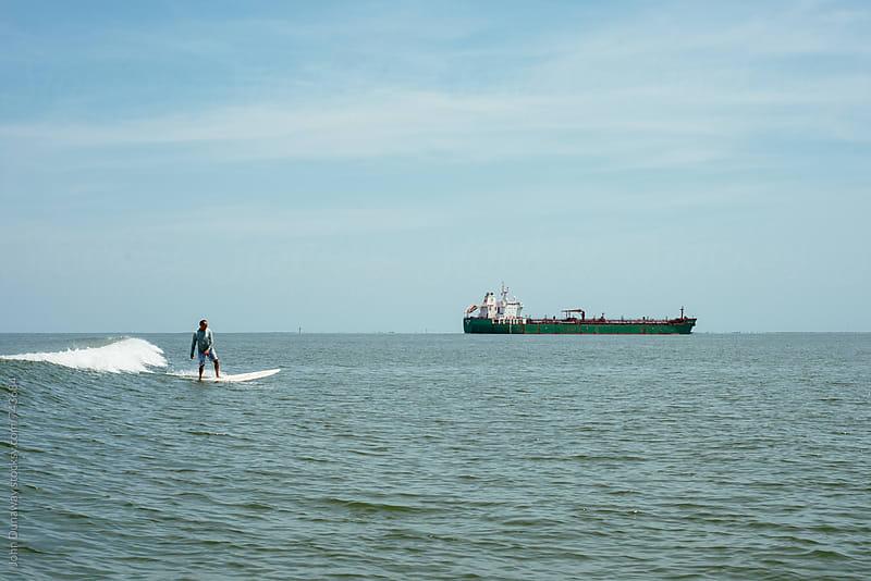 Texas Tanker Surfing by John Dunaway for Stocksy United