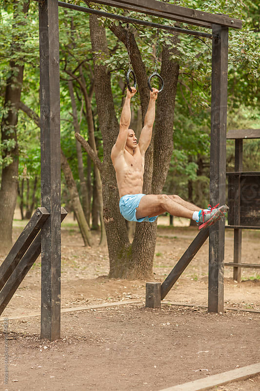 Man Doing Exercises in the Park  by Mosuno for Stocksy United