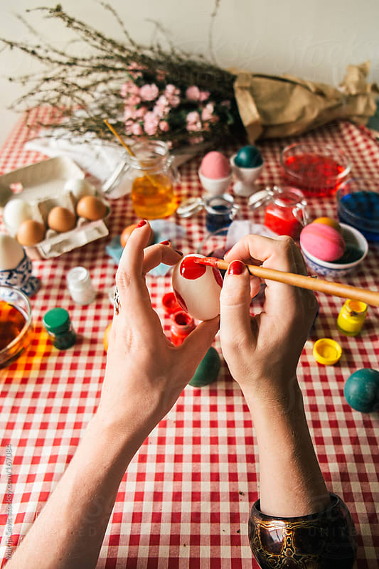 Woman Coloring Easter Eggs by Marija Savic for Stocksy United