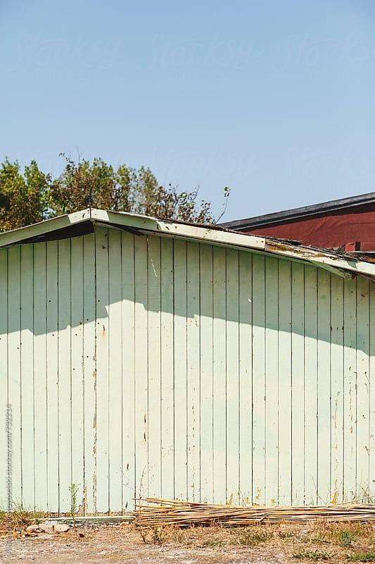 Wooden wall of a bungalow on the beach by Aleksandar Novoselski for Stocksy United