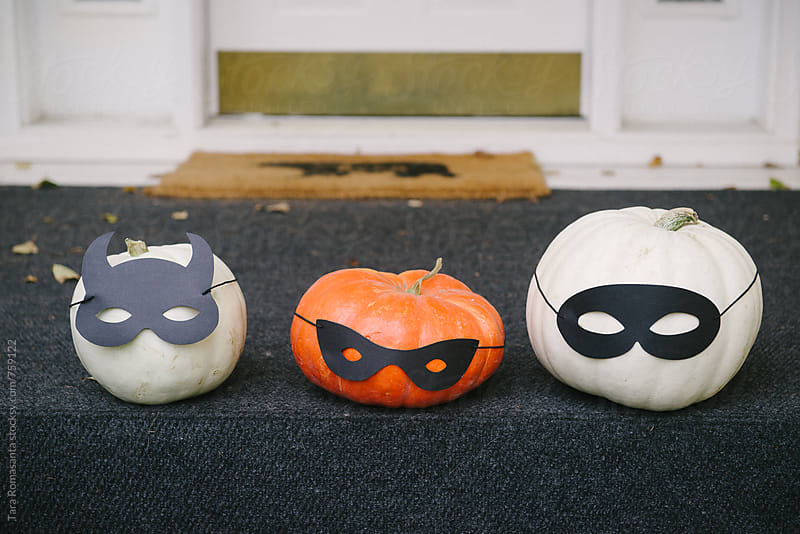three pumpkins on steps by Tara Romasanta for Stocksy United