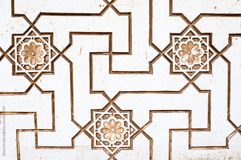 Detail of a wall with some arabs symbols in the Alhambra by Bisual Studio for Stocksy United