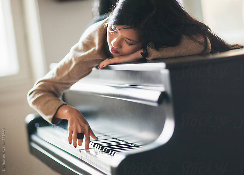 Woman Daydreaming on the Piano by Lumina for Stocksy United