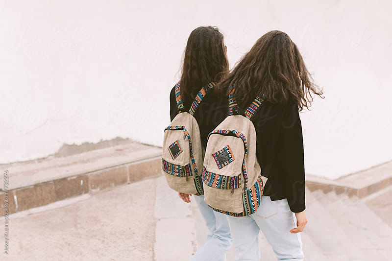 students twins with backpacks by Alexey Kuzma for Stocksy United