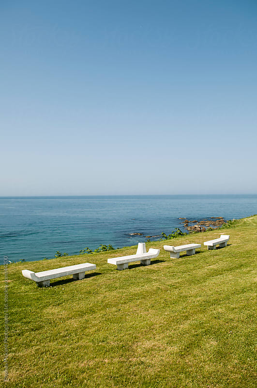 Chairs, grass and ocean, Hokkaido, Japan by Thomas Pickard for Stocksy United