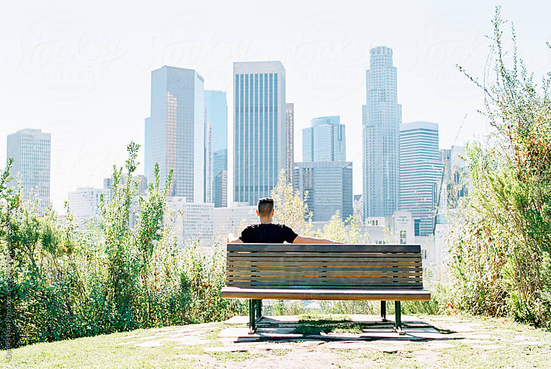 Man viewing downtown Los Angeles by Daniel Kim Photography for Stocksy United