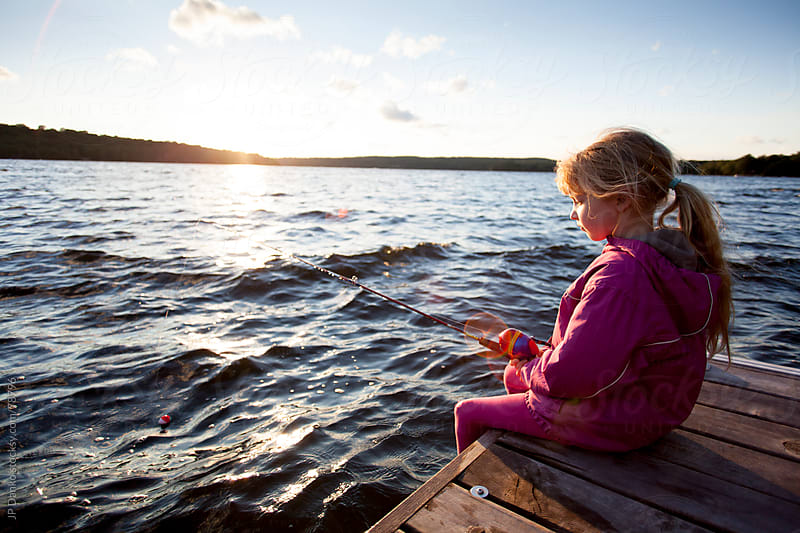 Little Girl Fishing From Dock at Cottage Lake by JP Danko for Stocksy United