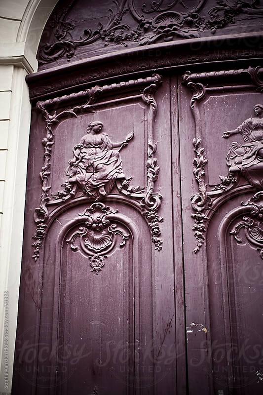Purple door in Paris by Sophia van den Hoek for Stocksy United