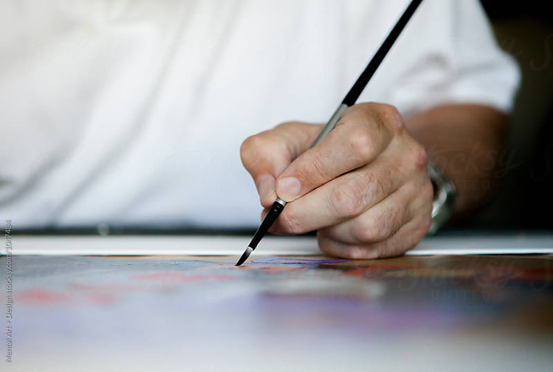 Hand. Retired, senior male. Artist working in his studio. by Mental Art + Design for Stocksy United