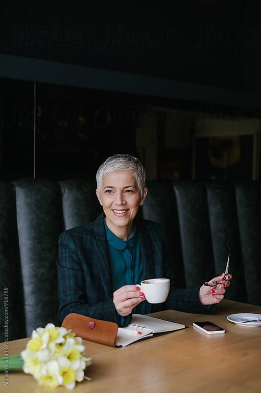 Smiling Businesswoman Working at the Cafe by Aleksandra Jankovic for Stocksy United