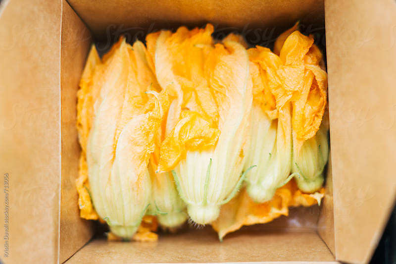 Squash blossoms by Kristin Duvall for Stocksy United