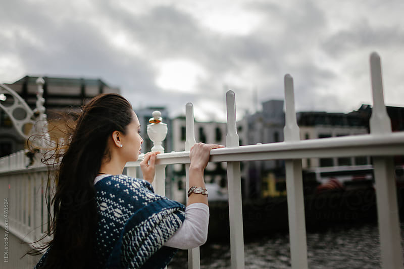 Pretty Asiatic Woman at Ha'Penny Bridge Dublin by HEX. for Stocksy United