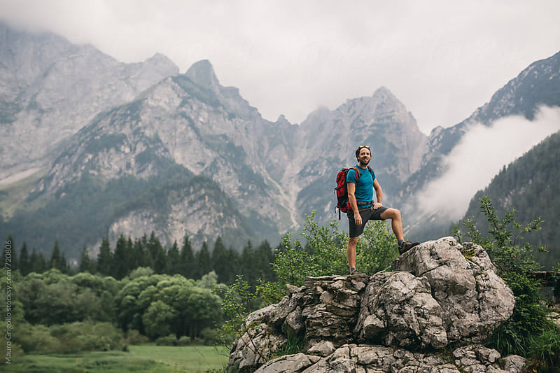 Hiker walking alone on Mountain by Mauro Grigollo for Stocksy United