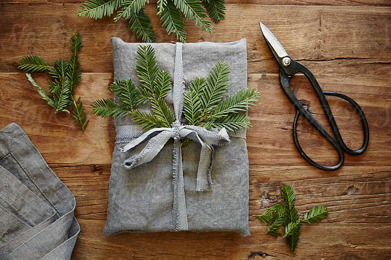 Still life of homemade linen wrapped christmas present by Trinette Reed for Stocksy United