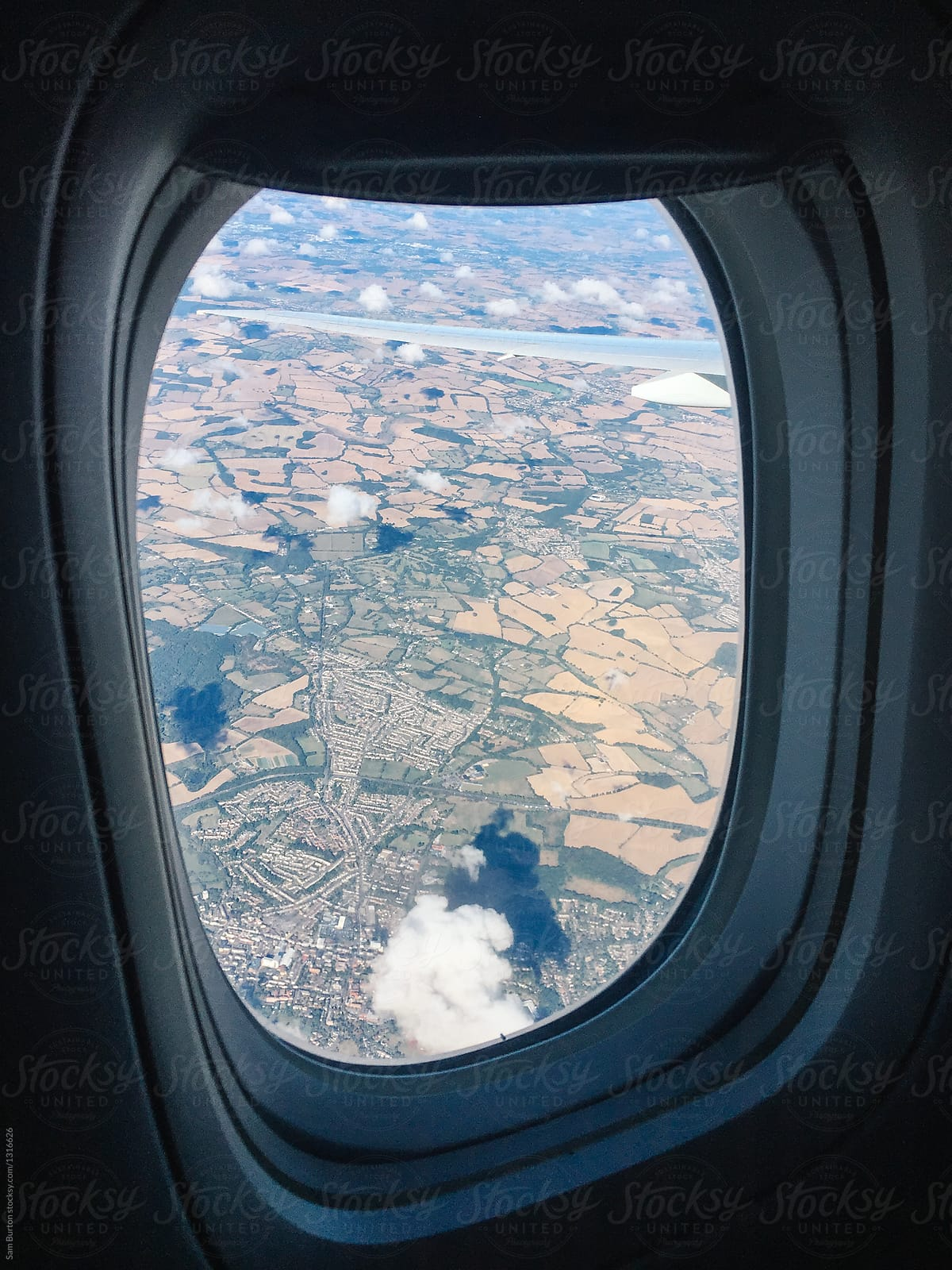 Airplane Window View By Sam Burton Aerial Aeroplane Stocksy