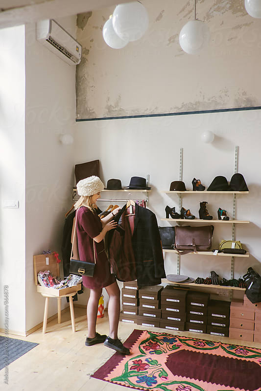 Woman Shopping in the Clothing Store by Aleksandra Jankovic for Stocksy United