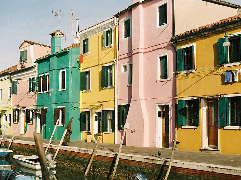 Colourful houses along a canal in Burano, Venice by Kirstin Mckee for Stocksy United