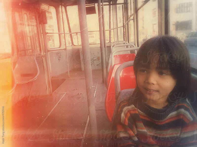 Cute kid on the bus by Nabi Tang for Stocksy United