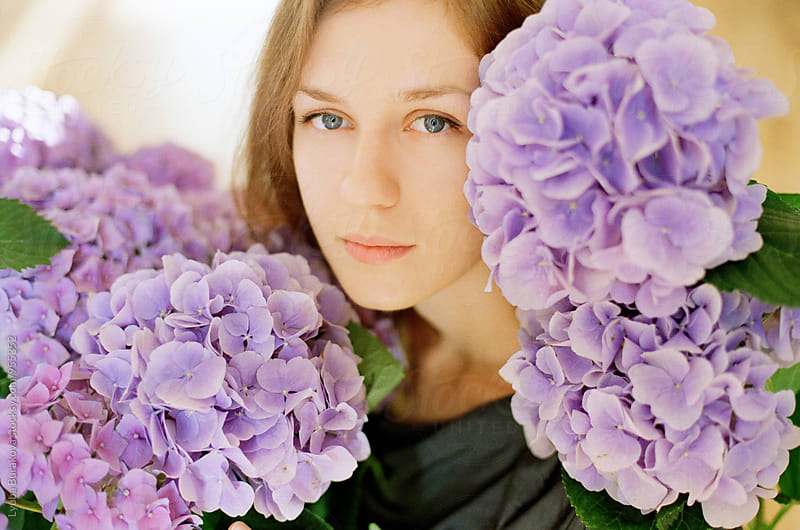 Portrait of a woman with flowers of hydrangea by Lyuba Burakova for Stocksy United