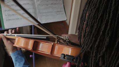 Black Girl Practicing Violin In Her Room | Stock Video | Stocksy United