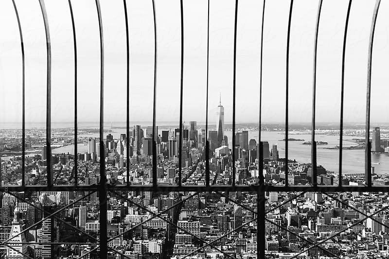 Views of Manhattan skyline from a fence. Black and white photo. by BONNINSTUDIO for Stocksy United