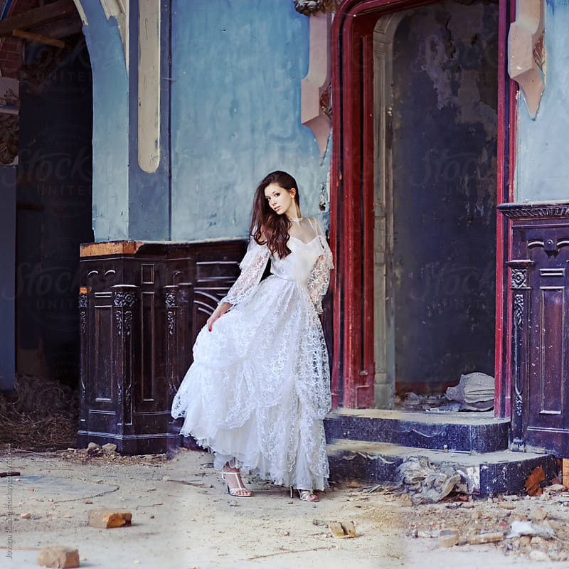 Beautiful girl in abandoned castle by Jovana Rikalo for Stocksy United