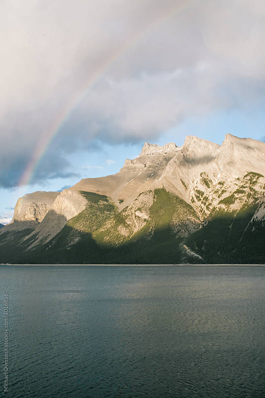 Rainbow over Lake Minnewanka by Michael Overbeck for Stocksy United