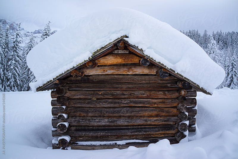 Mountain hut in snowy landscape by J.R. PHOTOGRAPHY for Stocksy United