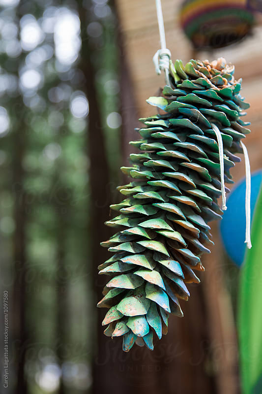 Hanging painted pinecone by Carolyn Lagattuta for Stocksy United