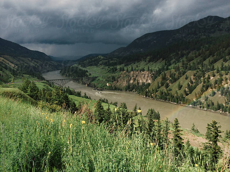 River Runs through Green Mountains by Kevin Russ for Stocksy United