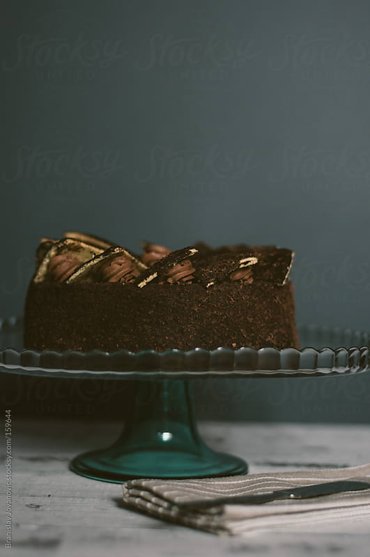 Delicious chocolate cake on the glass dish by Branislav Jovanovic for Stocksy United