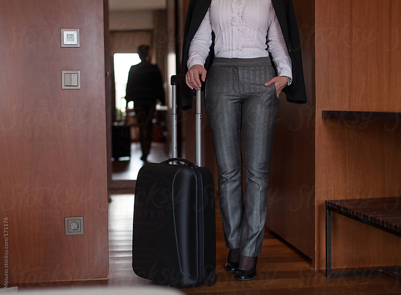 Anonymous Businesswoman Standing With the Suitcase by Mosuno for Stocksy United