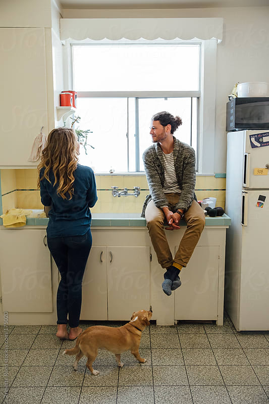 Couple hanging out in kitchen  by Trinette Reed for Stocksy United