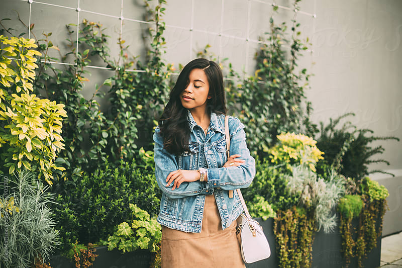 Attractive Young Woman In Denim Jacket And Tan Dress by Luke Mattson for Stocksy United