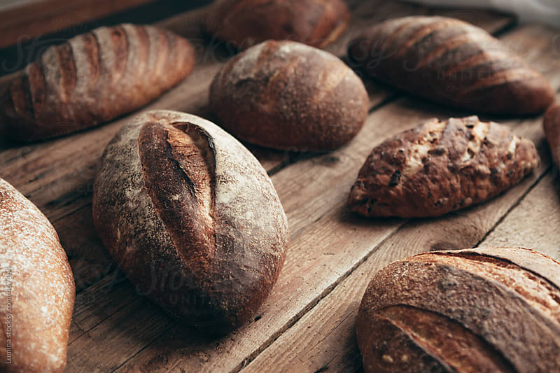 Loaves of Bread on Wood by Lumina for Stocksy United